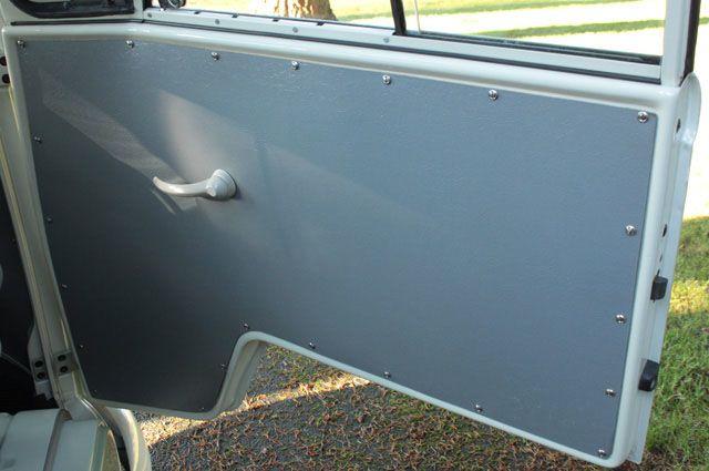 Front door panels are the proper grey hardboard versions...looking nice! & 1963 VW Panel Van Transporter For Sale @ Oldbug.com
