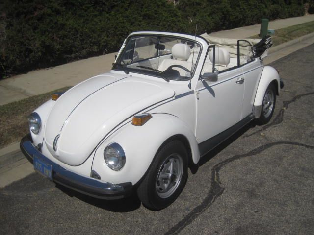 Triple white volkswagen beetle